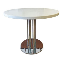 Chrome and White Bistro Table - This great little table can be used for a number of things. It's the perfect size for a small bistro table, kitchen, nook or even used as a side table on your patio or next to your lounge chairs. Table top is made of solid white laminate and very heavy, as well as the chrome base. The chrome is in excellent vintage condition with no chipping or pitting and the table top is bright white with no marks. Does have a small chip on the underside lip of the table, not on top and not noticeable unless you were looking extremely hard for it. Top is perfect. Great size for a small apartment, loft or condo and perfect table for that patio set.