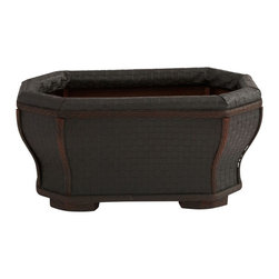 Shapely Planter - The classic look of wood and leather come alive in this stately planter. With the bold, darks of wood and leather, this handsome planter also features delicate curves and sturdy feet that give it an interesting appeal just perfect for some bright flowers or similar. Or use it to store magazines or similar - the possibilities are endless. Makes a thoughtful gift as well. Height= 6.75 in. x Width= 13.75 in. x Depth= 7.75 in.
