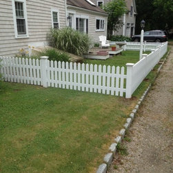 Cummaquid (on the Cape), MA - Low decorative white cedar fence on Cape Cod.  White Cedar with solid color white stain