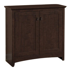 Bush - Bush Buena Vista 2 Door Low Storage Cabinet in Madison Cherry - Bush - Storage Cabinets - MY1389603 - Stylish enclosed storage works for books personal items or supplies. The Bush Furniture Buena Vista Madison Cherry 2-Drawer Low Storage keeps everything tidy and out of sight. Its attractive post leg design and curved base-rails fit most d��cor. Sophisticated look and sleek lines complement any room. Single inside shelf is adjustable up-and-down and enclosed by two doors. Aged bronze-metal hardware is both functional and contemporary. Works at home as a side cabinet or in an office as a combination bookshelf and storage unit. Small footprint allows room-placement flexibility. Solidly constructed and versatile the cabinet provides long life and offers total functionality. Mix and match with other pieces from the Buena Vista collection. Surface and edges resist impacts scratches and stains. Backed by the Bush Furniture 1-year Manufacturer's Warranty.