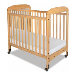 Foundations - Foundations Serenity Mirror End Compact Crib - Natural Multicolor - 1733040 - Shop for Cribs from Hayneedle.com! You might have to watch the vanity factor but the Foundations Serenity Mirror End Compact Crib - Natural is a great way to keep your baby happy while transitioning from sleep to wake time in the crib. One end panel is a mirror and the other is made of clear polycarbonate which lets you see your infant from any angle. Dependable quality construction features strong fasteners mortise-and-tenon joinery and a solid steel box frame mattress board that adjusts to two positions. Offering both value and safety for home or daycare settings this versatile compact crib is finished in a natural color and features subtle arches clear plastic teething rails and 2-inch non-marking ultra-quiet casters for easy mobility. The included Professional Series mattress is a highly durable antimicrobial mattress measuring a comfortable 3 inches thick. Additional Features: Mirror end panel keeps your baby entertained Clearview polycarbonate end panels make it easy to see your baby Subtle arches natural finish and antique brass hardware Compact size and a lower profile reduce back strain and provide easy access Traditional slatted sides are fixed for safety Quality mortise-and-tenon joinery and strong fasteners Smooth plastic teething rails protect your baby and crib sanitize easily Center-reinforced steel box frame mattress board adjusts to 2 positions Professional Series super-durable antimicrobial 3-inch-high mattress 2-inch non-marking ultra-quiet casters (2 locking) Made with responsibly harvested wood - complies with PEFC certification rib carries full 5-year warranty Frame casters and hardware carry lifetime warranty Matching crib drawer and evacuation frame system sold separately About FoundationsFoundations is a brand focused on the absolute safety and well being of all children and their products show it. Though used throughout the world by commercial custom