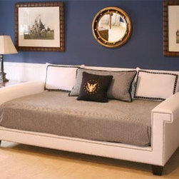 Hudson Day Bed - I like this daybed for a playroom because it looks like a couch, yet when you need the extra space for guests, it is also a roomy twin bed.