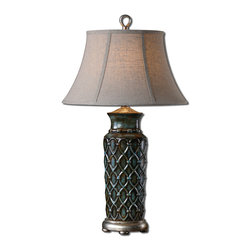 Uttermost - Valenza Table Lamp - Heavily burnished wash over a blue glaze with rust distressing and antiqued silver leaf details. The oval bell shade is an oatmeal linen fabric with light slubbing.