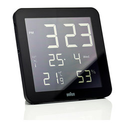 Braun - Braun BNC0014RC Digital Wall Clock - Braun's newest clock is a global radio-controlled digital wall clock. Displays 12/24 hour time, calendar date, day of the week, temperature and humidity. ABS slimline case with acrylic lens. Battery included. Manufactured by Braun.Design in 2012.