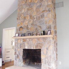 Modern Indoor Fireplaces by Design Builders & Remodeling Inc.