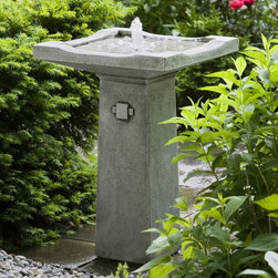 Campania International - Bjorn Bird Bath Fountain - FT-107-NA - Shop for Garden Bird Baths from Hayneedle.com! The Asian-inspired Bjorn Fountain is a beautiful asset to any garden and especially to Japanese and Asian gardens. The water flows smoothly into the base and recirculates within the fountain so no plumbing is necessary. Available in your choice of finish this fountain is hand-crafted from weather-resistant premium fiber reinforced cast stone concrete and the 6-foot cord plugs into a standard three-prong outlet. The Bjorn Fountain is available in the following finishes: natural antique bronze aged limestone alpine stone brownstone copper bronze chandoline English moss greenstone lead antique travertine and verde. Dimensions: 18L x 18W x 25H inches.About Campania InternationalEstablished in 1984 Campania International's reputation has been built on quality original products and service. Originally selling terra cotta planters Campania soon began to research and develop the design and manufacture of cast stone garden planters and ornaments. Campania is also an importer and wholesaler of garden products including polyethylene terra cotta glazed pottery cast iron and fiberglass planters as well as classic garden structures fountains and cast resin statuary.Campania Cast Stone: The ProcessThe creation of Campania's cast stone pieces begins and ends by hand. From the creation of an original design making of a mold pouring the cast stone application of the patina to the final packing of an order the process is both technical and artistic. As many as 30 pairs of hands are involved in the creation of each Campania piece in a labor intensive 15 step process.The process begins either with the creation of an original copyrighted design by Campania's artisans or an antique original. Antique originals will often require some restoration work which is also done in-house by expert craftsmen. Campania's mold making department will then begin a multi-step process to create a production mold which will properly replicate the detail and texture of the original piece. Depending on its size and complexity a mold can take as long as three months to complete. Campania creates in excess of 700 molds per year.After a mold is completed it is moved to the production area where a team individually hand pours the liquid cast stone mixture into the mold and employs special techniques to remove air bubbles. Campania carefully monitors the PSI of every piece. PSI (pounds per square inch) measures the strength of every piece to ensure durability. The PSI of Campania pieces is currently engineered at approximately 7500 for optimum strength. Each piece is air-dried and then de-molded by hand. After an internal quality check pieces are sent to a finishing department where seams are ground and any air holes caused by the pouring process are filled and smoothed. Pieces are then placed on a pallet for stocking in the warehouse.All Campania pieces are produced and stocked in natural cast stone. When a customer's order is placed pieces are pulled and unless a piece is requested in natural cast stone it is finished in a unique patinas. All patinas are applied by hand in a multi-step process; some patinas require three separate color applications. A finisher's skill in applying the patina and wiping away any excess to highlight detail requires not only technical skill but also true artistic sensibility. Every Campania piece becomes a unique and original work of garden art as a result.After the patina is dry the piece is then quality inspected. All pieces of a customer's order are batched and checked for completeness. A two-person packing team will then pack the order by hand into gaylord boxes on pallets. The packing material used is excelsior a natural wood product that has no chemical additives and may be recycled as display material repacking customer orders mulch or even bedding for animals. This exhaustive process ensures that Campania will remain a popular and beloved choice when it comes to garden decor.Please note this product does not ship to Pennsylvania.