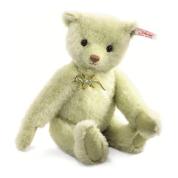 Lysander Teddy Bear EAN 034923 - Of all the creatures in Paradise Jungle, perhaps none is more exotic than Lysander. He wears a handmade brooch in the shape of a rain forest lizard, studded with sparkling green crystal stones. Like Laelia, his paw pads are made from the back side of his coat for a unique touch. His coat itself is a delicate green alpaca, custom-milled just for this piece by Steiff Schulte. Lysander is 5-way jointed so you can pose him any way you like during your tropical journey. Why not take him along with you?