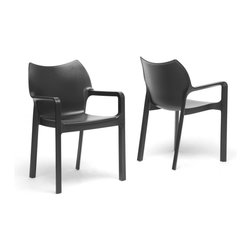 "Wholesale Interiors - Limerick Black Plastic Stackable Modern Dining Chairs, Set of 2 - Just one glance at our swoon-worthy Limerick Dining Chair will have you a fan for life! This designer chair is made with tough, thick, and durable black molded plastic that holds up beautifully indoors or out so you can create a modern retreat wherever you desire. The modern plastic chair design is made to be stackable, so when winter comes or when the party is over, you will not be hard-pressed to find a storage space. This Chinese-made designer dining chair is fully assembled and should be wiped clean with a damp cloth. Black not your color? This contemporary chair is also available in white or orange (each sold separately). Dimensions: 33.75 inches high x 22.5 inches wide x 20.25 inches deep, seat dimension: 19""W x 16""D x 18.25""H, Arm height: 25.625 inches."