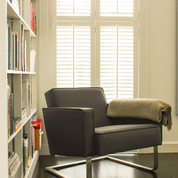 Webster Street Home - Liven up your reading nook.  This grey upholstered side chair is a nice addition with a little rock to it!