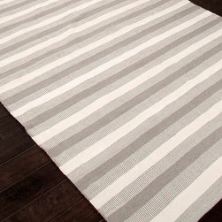 Birch Gray Indoor/Outdoor Rug - Each steel-grey stripe in the Birch Gray Indoor-Outdoor Rug is bordered by a mingled band of grey with the white that lies between them.  As a result, the rug has a rhythmic, balanced pattern of light and shadow that reduces the contrast and abruptness of the stripes, a sophisticated and fresh take on a classic pattern.  Enjoy the reversible rug's interest indoors and out.