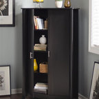 Bush - 2-Door Tall Storage in Classic Black - Adaptable and contemporary design. Two large and tall compartments. One stationary shelf. Attractive quarter turned legs. Large capacity storage. Chrome plated metal door. Sophisticated look and sleek lines. Wipe clean. Warranty: One year. Made from particleboard and laminates. 35.98 in. W x 15.35 in. D x 60.20 in. H (133.5 lbs.). Installation Guide