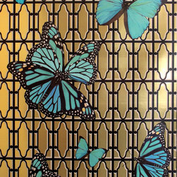 "Phyllis Morris - Butterflies Wallpaper, Turquoise on Gold - Imagine a room filled with butterflies soaring against a vintage grille motif. This bold design features large-scaled butterflies (the largest being 24"" wide) printed on heavyweight matte Mylar. It is printed at ""double width"" of 46"" with a vertical repeat of 72"" and is sold untrimmed by the running yard with a 3-yard minimum. Choice of two colorways: Magenta or Turquoise; and choice of two grounds: brushed metallic gold or brushed metallic nickel. Printed in the USA."