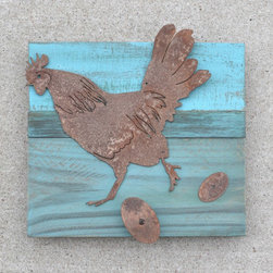 Chicken (rusted) on Turquoise frame - Made out of rusted steel, mounted on a painted reclaimed wood frame. Each piece is unique and will slightly vary from the picture depending on the wood's look.