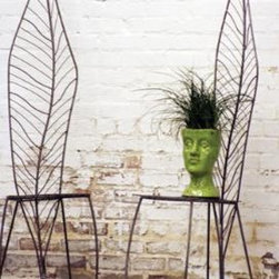 Leaf Chair - O.K., so they may not be the MOST comfortable seats around, but their sculptural beauty adds eclectic style to the garden.