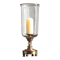 "Inviting Home - Crystal Hurricane Lamp - Hurricane lamp with hand-blown crystal chimney and cut crystal accents 8""x 21""H This stunning crystal hurricane lamp is hand crafted from solid brass and has a hand blown crystal chimney. Hurricane lamp has solid brass base and rim in antiqued finish. Round footed base of the hurricane lamp is lavishly embellished with beaded trim cut crystal accent and uprising scrolled leaf motif."