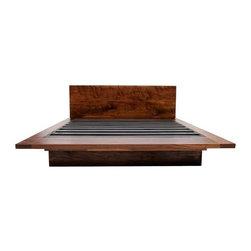 Artless - Artless   SQ Bed - SQ Bed is designed with beauty, function and a structural integrity for a lifetime of use. The detail of the design makes this the favorite piece from ARTLESS. This stunning bed is crafted from 2-inch solid black walnut with a hand rubbed oil finish. Behind the headboard you will find a 6-inch ledge which is ideal for storing books, lamps and pillows. The footboard of the bed extends beyond a mattress and is made for use as a bench or for storing extra blankets. Available in your choice of bed size. The legs and headboard of SQ Bed are detachable for easy transportation.  The Queen platform is a single frame, while the King and California King platforms are comprised of two interlocking L-shapes. Product Features:  Crafted to last a lifetime Made with 2-inch solid black walnut Hand rubbed oil finish for a deep, long-lasting luster The backboard ledge provides storage The footboard bench can be used for seating or storage Detachable legs and headboard
