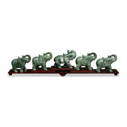 China Furniture and Arts - Jade Elephant Bridge with Stand - During the times of ancient China, elephants roamed many parts of the countryside, and their figure has been popular for centuries in Chinese households. Perceived as one of the most intelligent animals, the elephant has long been seen to symbolize wisdom and prosperity. Hand carved of green jade by artisans from China, they are presented here in a playful procession on a stepped stand.