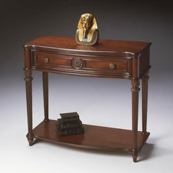 Butler - Butler Plantation Cherry Console Table 2130024 - Selected solid woods  wood products and choice veneers. Cherry veneer top  sides  drawer front and lower display shelf. Drawer with resin applique and antique brass finished hardware.