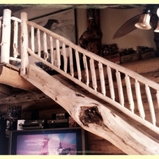 Unique Log Staircase  done by Mario's Log Work Ltd.