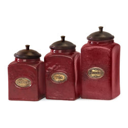 Imax Worldwide Home - Red Ceramic Canisters - Set of 3 - Set of 3. Material: 80% Ceramic, 10% Mango Wood, 10% Brass. Food safe. 6.75-7.25-7.5 in. H x 3.5 in. W x 3.5 in. D. Weight: 5.2 lbs.The vivid red finish of this canister set gives it a bright and cheery look. Each canister has a wood lid and features its own content label. Food safe.