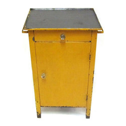 Consigned Metal Cabinet w/ Old Yellow Surface - Charming steel cabinet with drawer and lower cupboard. Pressed glass handles on each and towel rod on each side.