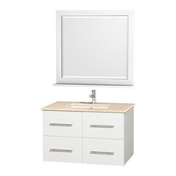"""Wyndham Collection(R) - Centra 36"""" Single Bathroom Vanity for Undermount Sinks by Wyndham Collection - W - The Wyndham Collection is an entirely unique and innovative bath line. Sure to inspire imitators, the original Wyndham Collection sets new standards for design and construction.Simplicity and elegance combine in the perfect lines of the Centra vanity by the Wyndham Collection®. If cutting-edge contemporary design is your style then the Centra vanity is for you - modern, chic and built to last a lifetime. Available with green glass, pure white man-made stone, ivory marble or white carrera marble counters, and featuring soft close door hinges and drawer glides, you'll never hear a noisy door again! The Centra is available with porcelain sinks and matching mirrors. Meticulously finished with brushed chrome hardware, the attention to detail on this beautiful vanity is second to none.Centra Bathroom Vanities are available here in multiple sizes and finishes and are now available with optional CaesarStone® counters!FeaturesConstructed of environmentally friendly, zero emissions solid Oak hardwood, engineered to prevent warping and last a lifetime12-stage wood preparation, sanding, painting and finishing processHighly water-resistant low V.O.C. sealed finishUnique and striking contemporary designModern Wall-Mount DesignMinimal assembly requiredDeep Doweled DrawersFully-extending under-mount soft-close drawer slidesConcealed soft-close door hingesCounter options include Green Glass, Pure White Man-Made Stone, Ivory Marble, White Carrera Marble, and CaesarStone (many colors available)Backsplash not availableAvailable with Porcelain undermount sink(s) Pre-drilled for asingle hole faucetFaucet(s) not includedMetal exterior hardware with brushed chrome finishTwo (2) functional doorsTwo (2) functional drawersMatching mirror(s) availablePlenty of storage spacePlenty of counter spaceVariations in the shading and grain of our natural stone products enhance the individuality of"""