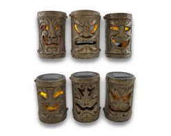 Zeckos - Set of 6 Friki Tiki Flickering Solar Accent Lights Island Decor - This set of 6 cool Polynesian tiki solar garden lights is perfect for adding some pathway light to your garden or landscaping. They can be mounted to the top of fence posts, can stand on their own poles, and also make great centerpiece candles for patios and restaurants. The lights turn on automatically in dark conditions and last up to 10 hours under a full charge. The lights are yellow LEDs that flicker like candles when lit to provide you with warm, calm light without having to worry about the wind. Made of resin to resemble carved wooden tikis, each light measures 6 inches tall, 3 3/4 inches in diameter. They come with extension poles, post mounting brackets, ground stakes and connectors for the extender poles. This set is great for anyone with a tiki bar.