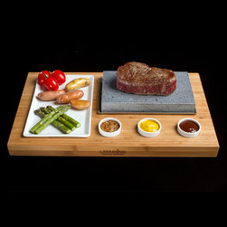 Frontgate - Red Rock Cooking Stone Set - Durable, indestructible lava rock stone from volcanic Mount Etna in Sicily, Italy. Lava Rock will retain some of the oil used in cooking, will darken with use and age. Set includes: Wooden Bamboo Base, Ceramic Platter, Three Ceramic Condiment Dishes, One Lava Stone in Stainless Steel Tray. Wash Lava Rock with hot, soapy water. Wipe Bamboo Base clean with a damp cloth. The Lava Rock Cooking Stones Set is a perfect and healthy way to cook steak, fish and vegetables, whilst also creating that little bit of theater that transforms a meal into an event. Once heated to 500-600 Fahrenheit, the rock will remain hot enough for you to cook your chosen food to your own taste, thus guaranteeing personal perfection, bite after bite.  .  .  .  .  . Ceramic Dishes and Stainless Steel Tray are dishwasher safe . Made in Italy.