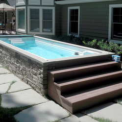 Endless pools backyard swim spa the endless pool swim for Above ground pool siding ideas