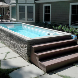 Endless Pools® Backyard Swim Spa - The Endless Pool Swim Spa offers our patented adjustable swim current for exercise and hydrotherapy jet seats for relaxation. The stacked-stone siding makes this above-ground installation clean and elegant.