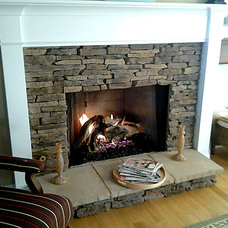 Traditional Indoor Fireplaces by Southern Hearth & Patio