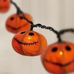 Jack O'Lantern Burlap String Lights - Stitched from natural burlap, these smiley pumpkins light up the night with homespun charm. They appear to float as if by magic after dark when hung from the trees. 8' long 10 orange burlap pumpkins cover mini-bulb lights. Hangs from a black cord; prong-style plug in. Includes four replacement bulbs. For both indoor or outdoor use; avoid contact with water. UL listed. Catalog / Internet only.