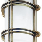 LBL Lighting - Clipper/G Outdoor Wall Sconce by LBL Lighting - The LBL Lighting Clipper/G Outdoor Wall Sconce displays the beauty and durability of nautical lighting, both inside the fixture and out. It features a frosty, internally Ice Etched glass cylinder held within a strong, barred metal frame (available in Chrome or Brass). Incandescent or energy efficient fluorescent lamping is available.For more than 40 years, Illinois-based LBL Lighting has created innovative lighting fixtures based on the principles of beauty, originality and quality. Such values remain evident in their current line of fixtures, which feature distinctive elements like organic art glass, solid construction and the latest low voltage and LED lighting technology.The LBL Lighting Clipper/G Outdoor Wall Sconce is available with the following:Details:Internally Ice Etched glass shadeMetal constructionBrass lock screwsPolymer gasketEnergy efficient fluorescent options availableETL Listed for wet locationsOptions:Finish: Brass, or Chrome.Lamping: Fluorescent with High Electronic Ballast, or Incandescent.Lighting:Fluorescent with High Electronic Ballast option utilizes one 26 Watt 120 Volt Quad Compact Fluorescent lamp (included).Incandescent option utilizes one 75 Watt 120 Volt Incandescent E26 base A19 lamp (included).Shipping:This item usually ships within seven to ten business days.