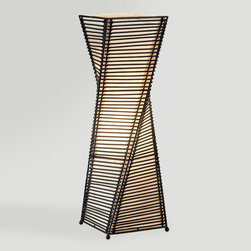 World Market - Kyoto Table Lamp - Our sculptural Kyoto Table Lamp takes its design cue from the architecture found in the temples of Japan's former imperial city of Kyoto. The twisting tower is meticulously created out of stacked and woven black cane sticks and then lined with a beige paper that diffuses light into a warm glow on your tabletop or desk. Ideal for complementing your Asian fusion décor or to bring a structured art piece to an ultra chic space.