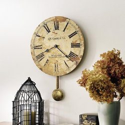 "Accent & Decor - Feel like you're living in Devonshire, England around the turn of the century with this John Gould-inspired wall clock. This Moment In Time clock offers an authentic facsimile recaptures the timeless essence of Old World craftsmanship with its antique dials, which are carefully mounted on laser cut, 1/4"" thick, panel bases and feature antique black hands and a quartz movement. Plus, antiqued pendulum extends 5"" beneath dial. Bring a taste of the past back to the present with this unique round wall clock."