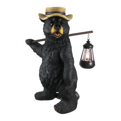 Zeckos - Funny Country Bear with Lantern Statue Outdoor Figure - This wonderfully detailed country bear outdoor statue carries a lantern that holds a battery powered accent light Made of cold cast resin, the bear measures 16 1/2 inches tall, 10 inches wide and 11 inches deep. He's hand-painted, and shows great detail. The lantern opens from the bottom, allowing you to change out the 2 AA batteries when needed. This statue makes a wonderful gift for any bear lover.