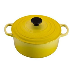 Le Creuset Signature 4.5 qt. Round French Oven - Soleil - The high-quality cast iron construction of the Le Creuset Signature 4.5 qt. Round French Oven – Soleil is perfect for braising meats, slow-cooking stews and so much more. The bold and bright yellow enamel finish gives this Dutch oven some pizzazz and it is sure to give you and your family years of delicious enjoyment. About Le Creuset of America Inc.From its cast iron cookware to its teakettles and mugs, Le Creuset is a global standard of inimitable color and quality. Founded in 1925 in the northern French town of Fresnoy-Le-Grand, Le Creuset still produces enameled cast iron in its original foundry. Its signature color, Flame, was modeled after the intense orange hue of molten cast iron within a cauldron (or creuset in French), and has been a Le Creuset bestseller from the company's first year to the present day.Though best known for its vibrantly colored cookware and original inventions such as the Dutch oven, Le Creuset has also forged a name as a creator of stoneware mugs and enamel-coated stainless steel teakettles. The style and performance of Le Creuset's Cafe Collection and tea accessories are rooted in classic French cookware: bold colors, cylindrical loop handles, unmatched thermal resistance and heat distribution, and of course the iconic Le Creuset three-ring accent. Through its consistent qualities of authenticity, originality, and innovation, Le Creuset maintains a connection to both heritage and modernity.