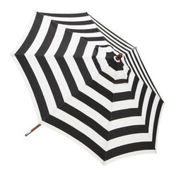 Sunbrella Round Umbrella, Awning Stripe - The black and white stripes on this umbrella call attention to an otherwise forgotten backyard staple.