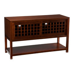Holly & Martin - Holly & Martin Akita Media Console-Espresso - This elegant media console combines today's need for technology storage with style to die for. Two sliding doors make it easy to access and store all your TV accessories such as DVD's, and gaming consoles. A bottom shelf is perfect for storage of pillows, blankets, or to display family photos, the possibilities are endless! With elegant lattice styling and a deep espresso finish, this media console is perfect for any room in the home.