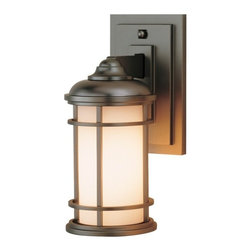Feiss Lighting - 11-Inch Outdoor Wall Light - OL2200BB - This contemporary outdoor wall light was designed with the style of a lighthouse in mind. Mounted against the wall with a subtly stepped rectangular base, this sturdy fixture is constructed of die-cast zinc, with the bars of its shade's cage made of solid brass. The cream-colored glass contrasts well with the deep bronze finish, which is a triple-plated and powder-coated lacquer for durability and weather resistance. Measures 11 inches in height, extends 6 inches from the wall. Backplate measures 7-1/2 inches high by 4-1/2 inches wide. Takes (1) 100-watt incandescent A19 bulb(s). Bulb(s) sold separately. Wet location rated.
