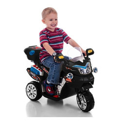 Lil Rider - Lil Rider FX 3 Wheel Motorcycle Bike Battery Powered Riding Toy - Black - 80-KB9 - Shop for Tricycles and Riding Toys from Hayneedle.com! Have a young one who feels the need for speed? The Lil Rider FX 3 Wheel Battery Powered Bike - Black will be the Best Present Ever! With a 15 Watt motor that runs forward and in reverse your child will enjoy powering around on lawn and pavement. Its headlights turn on and off and let the fun sound effects blare at the touch of a button. Includes a rechargeable battery and charger that plugs into a standard AC110V outlet. Requires adult supervision. Keep children away from roads and moving vehicles.