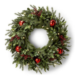 "Grandin Road - Battery-operated Holly and Berry Christmas Wreath - Rich mix of holly and pine. Accented with red berries, red ball ornaments, and white mini-lights. 6-hour timer turns on/off at the same time every day. Runs on 2 ""D"" batteries (not included). Our Battery-operated Holly and Berry Wreath allows you to enjoy a pre-lit, professionally decorated look without cumbersome cords. This all-weather piece is battery-operated, so you can do your holiday decorating anywhere, indoors or outdoors.  .  .  . Runs on 2 ""D' batteries (not included) ."