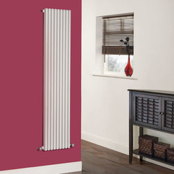 Hudson Reed - Parallel White Single Panel Vertical Designer Radiator 63 x 13.5 - Parallel Single Panel Designer Radiator Sideways 63 x 13.5 Part of the exciting Parallel range, the Luxury White Vertical Designer Radiator 63 x 13.5 combines designer looks and expert manufacturing for a flawless performance. Vertical mounting means this compact radiator is not just space saving but also a step away from conventional radiator designs.  Key features of this luxury radiator are its flat panel finish and a hint of the traditional in its column array.  As well as its outstanding looks this radiator delivers a fantastic heat output of 1,520 Watts (5,182 BTUs).  The Parallel - Luxury White Vertical Designer Radiator is compatible with hot water central heating systems and it will plumb directly into your existing pipe work. This product comes complete with wall mounting brackets and fixing kit.  Parallel Single Panel Designer Radiator 63 x 13.5 Details   Dimensions: (H x W x D) 63 (1600mm) x 13.5 (342mm) x 3.25 (82mm) Output: 1,520 Watts (5,182 BTUs) Max Projection: 4.5 (115mm) Pipe centres with valves (Approx): 17.75 (450mm) Wall to centre of tapping: 2.5 (65mm) Number of columns: 9 - 0.9 (22mm) thickness Fixing Pack Included Designed to be plumbed into your central heating system Suitable for bathroom, cloakroom, kitchen etc. Please note: Modern angled radiator valves included  Buy now, to transform your bathroom or other living space, at an affordable price. Please Note: Our radiators are designed for forced circulation closed loop systems only. They are not compatible with open loop, gravity hot water or steam systems.