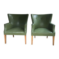 Vintage Green Leather Chairs - Say it with me, folks: olive this rare pair of vintage leather chairs with gorgeous nailhead trims. The sophisticated, classic style and  neutral olive green tone ensure that these chairs would look perfect in a library, living room, dining room, or at the foot of a bed. They are a hybrid between traditional wing-back, nailhead chairs and funky Mid-Century Modern ones, so they will look good just about anywhere.
