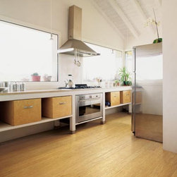 Honey Bamboo Strand Flooring - Years ago I had a bad experience with bamboo floors: They showed every dent and divet. But I understand the product has improved, so this beautiful honey-toned flooring is now a good option.