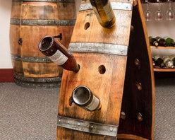 Napa East Wine Barrel A Frame Riddling Rack - Storing wine doesn't have to be boring when you have the Napa East Wine Barrel A Frame Riddling Rack. Show off your prized collection of wines with flare in this A-shaped wine rack made from a reclaimed oak wine barrel. It holds up to 16 bottles and can be moved easily for convenient positioningAbout Napa EastNapa East creates wine-inspired furnishings that are made from actual reclaimed oak wine barrels. Their barrels began life handcrafted with pride from the finest French and American Oaks, and Napa East continues that theme when they hand-select barrels and giving them new life as beautiful one-of-a-kind works of art.