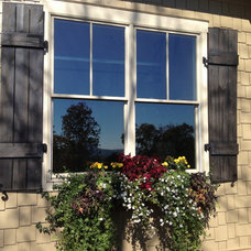 Eclectic Windows by Total Quality Home Builders, Inc.