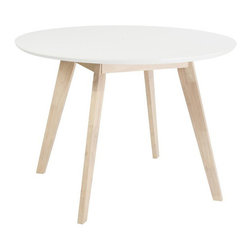 White Wash Dining Table - Round - You enjoy the simple things in life. A single flower on a night stand. A glass of red wine. And a white table to top it all off.