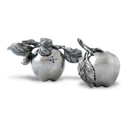 Apple Salt and Pepper Shakers - Glowing smooth skin and soft, creased leaves make the Apple Salt and Pepper Shakers a romantic replica of the first ripening fruits in an autumn orchard while the holes drilled in the sides make them functional as well as sculptural. Set to hide the holes, they become permanent artwork for a vignette; on your table, they're a personable and lovely detail.