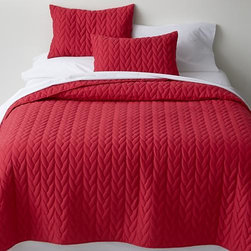 Red Cable Full-Queen Quilt - Braided cotton rope design cozies the bed with loads of quilted texture in rosy red that looks festive all by itself or layered with loads of decorative pillows.